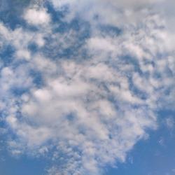 Clouds in sky. White clouds in blue sky. Sunny weather. Cloudscape. Rainy weather. Cloudscape background.