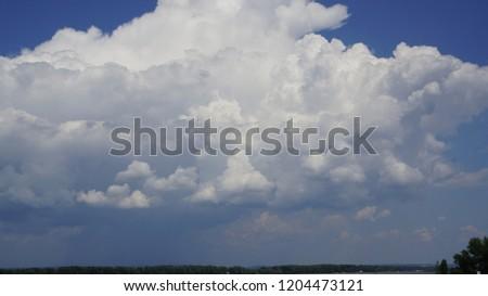 Clouds in the blue sky #1204473121