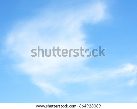 clouds in the blue sky - Shutterstock ID 664928089