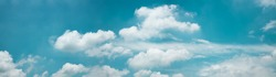 Clouds in the Blue Sky on Sunny Day, Nature Scenery with a Good Weather. Looking Up Shot. Long and Wide Screen