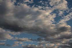 Clouds in the sky. The wonderful spectacle of a sky full of clouds. Depth and three-dimensionality of a cloudy sky.