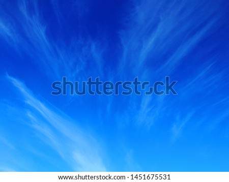 Clouds in the stratosphere, blue sky texture background #1451675531