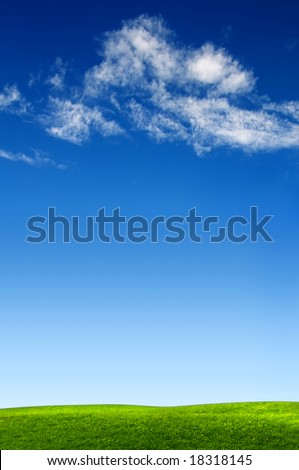 clouds on blue sky above green meadow