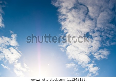 clouds on blue sky and sun rays
