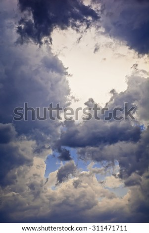 Clouds on the blue sky before the storm on a summer hot day. The sudden change in the weather. Calm before the storm.