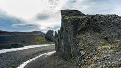 Clouds over rock formations, Vesturdalur Valley, Norourping, Northeastern Region, Iceland
