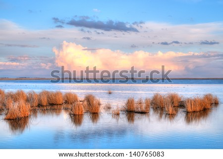 Clouds over wetlands at Sunset, Frank Lake Alberta Canada