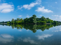 Clouds reflected at Loire river in La Chapelle-aux-Naux village of Indre-et-Loire Department of the Loire valley in France, Europe