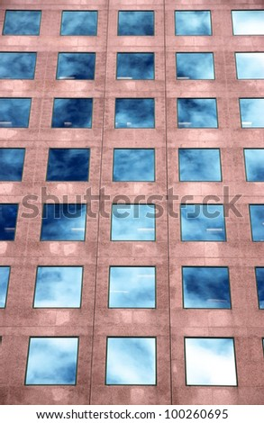 Clouds Reflected in Windows