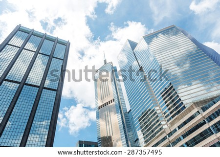 Clouds reflected in windows of modern office building #287357495