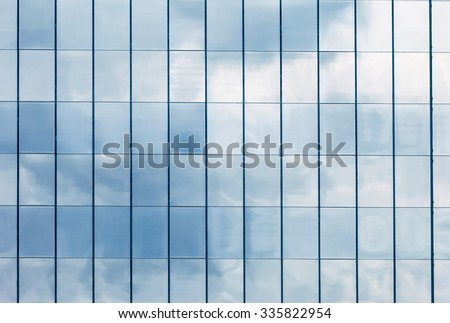 Clouds Reflected in Windows of Modern Office Building. stock photo