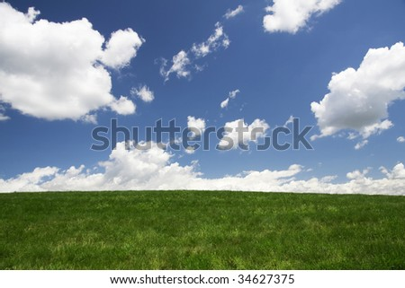 Clouds rolling over green pasture