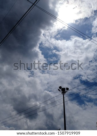 Clouds sky light poles electricity poles #1507919909
