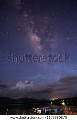 Clouds, stars and the Milky Way in the night sky. #1178890870