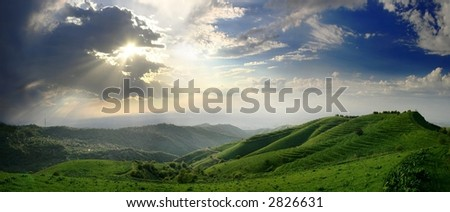 clouds, sun beam and green hills (panorama of 6 shot)
