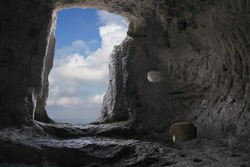 Clouds through the cave door in Eski-Kermen ancient cave town
