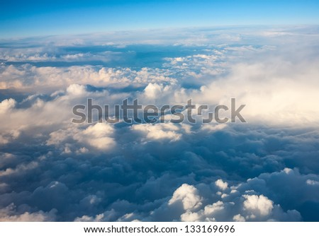 clouds. top view from the window of an airplane flying in the clouds. cloud spreading to the horizon