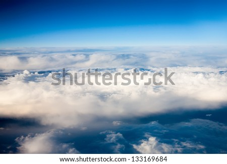 clouds. top view from the window of an airplane flying in the clouds. clouds like an ocean storm