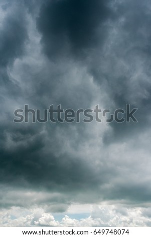 clouds with background,sunlight through very dark clouds background of dark storm clouds, black sky Background of dark clouds before a thunder.