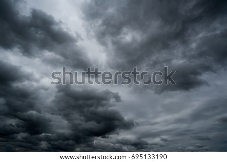 clouds with background,sunlight through very dark clouds background of dark storm clouds, black sky Background of dark clouds before a thunder. #695133190