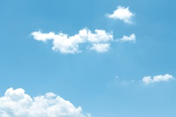 Clouds with light wind on bright bluesky background and copy space