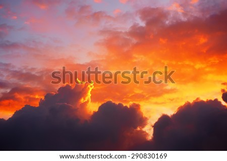 cloudscape at sunset with dramatic red clouds