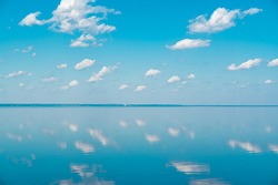 cloudscape. clouds in the blue sky and reflection in a large lake. big beautiful clouds in the morning on the sea. , big cloud above lake panorama, horizon, beautiful sunny summer day