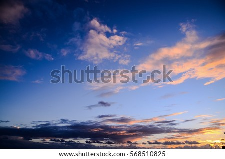 Cloudscape, Colored Clouds at Sunset near the Ocean #568510825