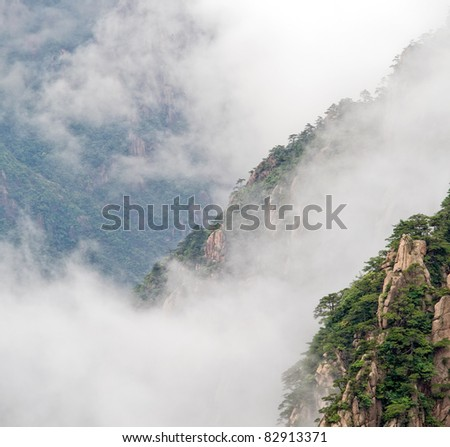 Cloudscape image of  Huangshan (yellow mountain) and pine tree on the top(like avatar). Foggy day, Huang Shan, China.