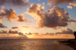 Cloudscape over Ocean and Island at Sunset - Rarotonga, Cook Islands, Polynesia