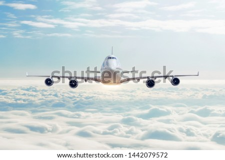 Cloudscape view with airplane is flying in the daytime sky cumulus clouds #1442079572