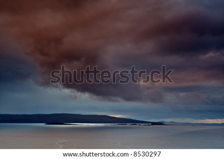Cloudy and dramatic stormy sky over the Loch Snizort, Isle of Skye, Scotland