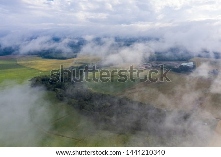 Cloudy and misty morning in latvian countryside. #1444210340