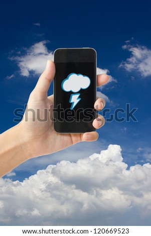 Cloudy and  thunderbolt icon on touch screen mobile phone, weather forecast concept. - stock photo