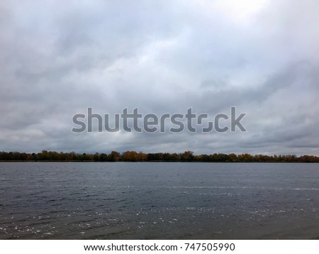 cloudy autumn gray lake in the fog