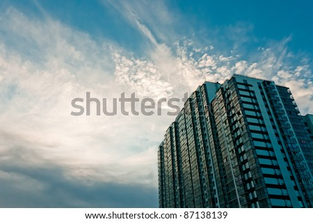Cloudy, beautiful sky and high apartment house