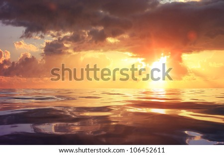 cloudy blue sky and sea surface at sunset