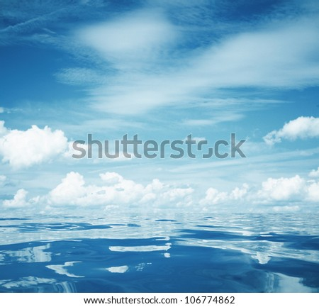 cloudy blue sky and still sea surface