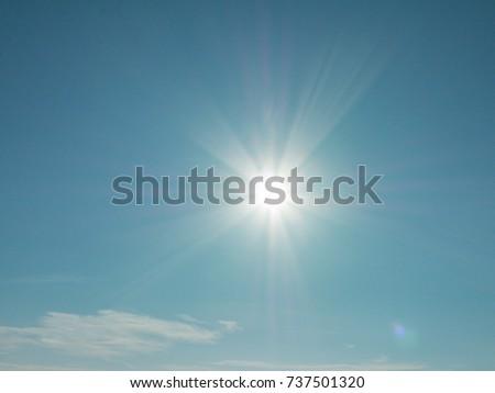 cloudy blue sky and sun #737501320
