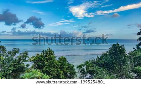 Cloudy blue sky, calm blue Indian Ocean, Seychelles, Mahe, Beau Vallon Photo stock ©