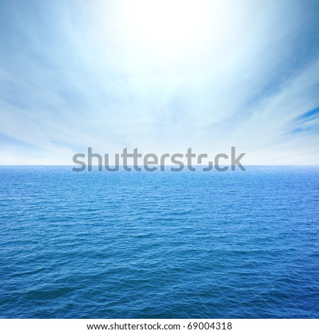 cloudy blue sky leaving for horizon above a blue surface of the sea