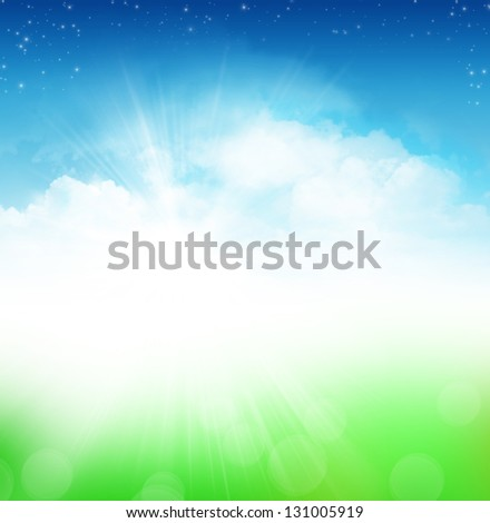 Cloudy blue sky with stars and green field abstract background
