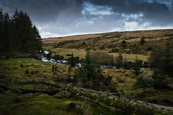 Cloudy Day, River Flowing Through Rugged Countryside