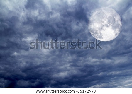 cloudy dramatic sky with spooky moon as Halloween background [Photo Illustration]
