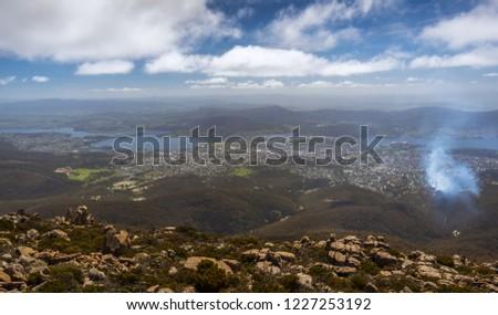 cloudy hazy morning view Mount Wellington Hobart city coastal sunny morning rocky landscape mountains