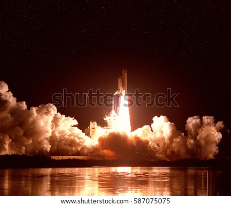 Cloudy launch of rocket into  outer space. \