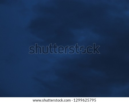 Cloudy nighttime sky in shades of midnight blue to royal blue #1299625795