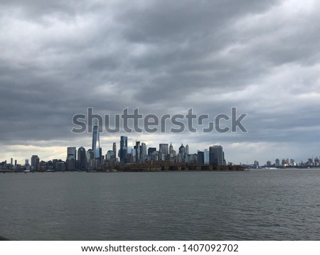 Cloudy NYC skyline from New York Harbor