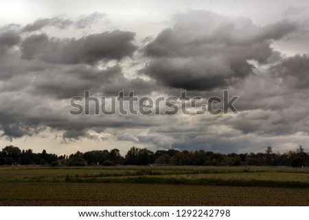 cloudy panorama of agricoltural green fields #1292242798