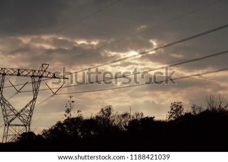 Cloudy Powerline Sunset. #1188421039